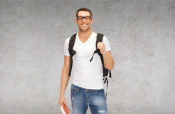 Smiling student with backpack and book Stock Images