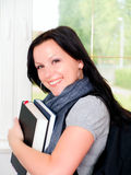 Smiling student with backpack holding books Stock Photos