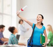 Smiling student with bag and folders Royalty Free Stock Photo
