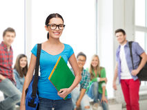 Smiling student with bag and folders Stock Images