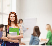 Smiling student with bag, folders and tablet pc Stock Photography