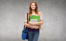 Smiling student with bag, folders and tablet pc Royalty Free Stock Photography