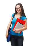 Smiling student with bag, folders and tablet pc Stock Photos