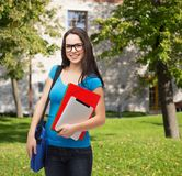 Smiling student with bag, folders and tablet pc Stock Images