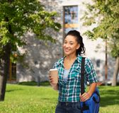 Smiling student with bag and take away coffee cup Royalty Free Stock Photography