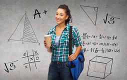 Smiling student with bag and take away coffee cup Stock Photos