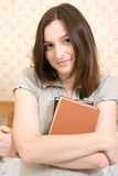 Smiling student with a book Royalty Free Stock Images