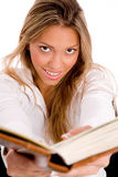 Smiling student with book looking at camera Royalty Free Stock Photography
