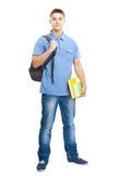 Smiling student with books and backpack Stock Photos