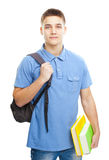Smiling student with books and backpack Stock Photo