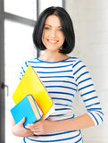 Smiling student with books and notes Stock Photography