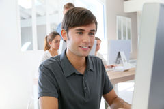 Smiling student boy amongst others Royalty Free Stock Image