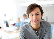 Smiling student in class. Portrait of smiling student in school class Royalty Free Stock Photos