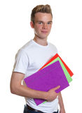 Smiling student with colorful record in his hand Stock Photo