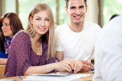 Smiling student couple Stock Images