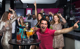 Smiling student is dancing on party. In the bar Stock Image