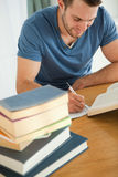 Smiling student doing book report Stock Image