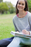 Smiling student doing her homework Royalty Free Stock Photo