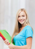 Smiling student with folders Royalty Free Stock Photo