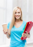 Smiling student with folders Royalty Free Stock Photos