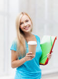 Smiling student with folders Royalty Free Stock Image