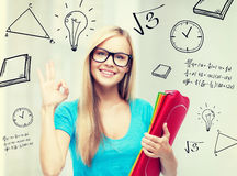Smiling student with folders Stock Image