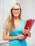 Smiling student with folders Stock Photo