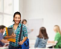 Smiling student with folders, tablet pc and bag Royalty Free Stock Image