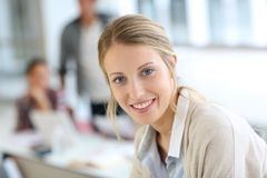 Smiling student girl attending class. Portrait of beautiful smiling student girl Stock Photos