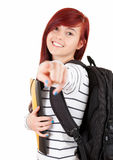 Smiling student girl with black rucksack pointing Stock Image