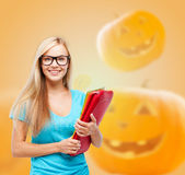 Smiling student girl with books and backpack Stock Photos