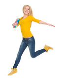 Smiling student girl with books jumping royalty free stock photo