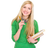 Smiling student girl with books and pen Royalty Free Stock Photo
