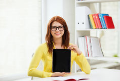 Smiling student girl in eyelgasses with tablet pc Royalty Free Stock Images