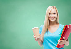 Smiling student girl with folders and coffee cup Stock Images