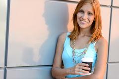 Smiling student girl holding coffee cup summer Royalty Free Stock Photography