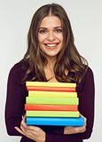 Smiling student girl holding pile, stack of books. Toothy smiling student girl holding pile, stack of books. Isolated portrait Royalty Free Stock Images