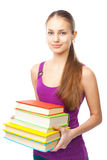 Smiling student girl holding stack of books Royalty Free Stock Images