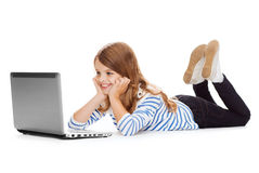 Smiling student girl with laptop computer lying Stock Images