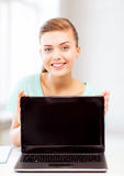Smiling student girl with laptop Royalty Free Stock Photos
