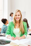 Smiling student girl with laptop at school Stock Image
