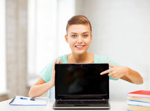 Smiling student girl with laptop at school Royalty Free Stock Photo