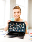 Smiling student girl with laptop at school Stock Photography