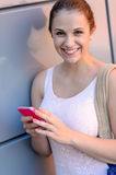 Smiling student girl with mobile phone Royalty Free Stock Photos