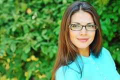 Smiling student girl outdoors portrait close-up.  Royalty Free Stock Photos