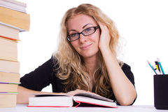 Smiling student girl with pile of books Stock Photography