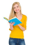 Smiling student girl reading book Stock Photography