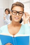 Smiling student girl reading book at school Royalty Free Stock Photography