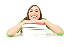 Smiling student girl resting on the stack of books Stock Photo