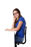 Smiling student girl sitting at the desk Royalty Free Stock Photo